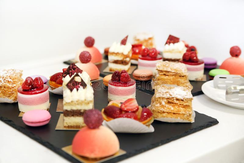 Desserts with fruits, mousse, biscuits stock image