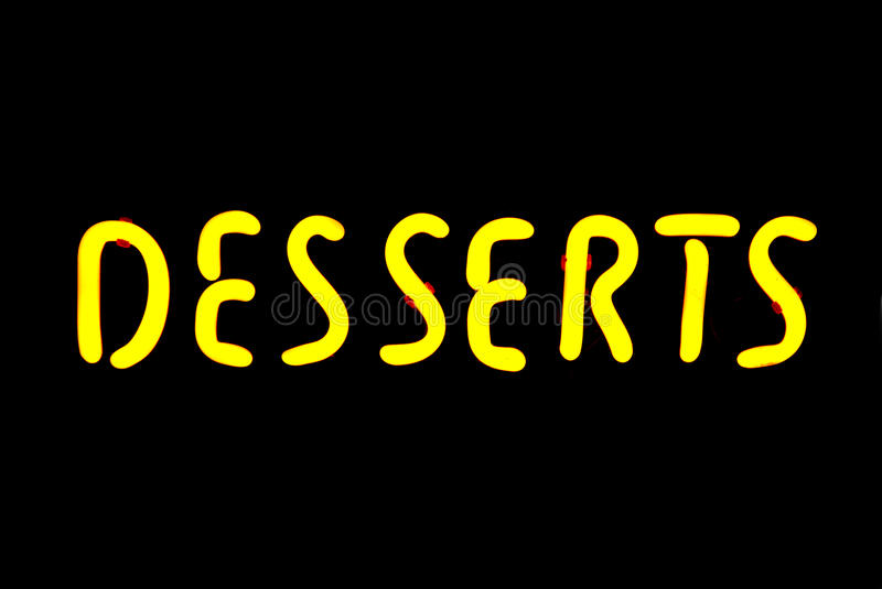 Desserts Neon Sign. Yellow desserts neon sign isolated on black background royalty free stock photography