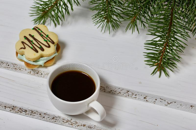 Desserts for winter parties. Sweets and spruce branch. Marshmallows and a cup of coffee. Desserts for winter parties. Sweets spruce branch royalty free stock images
