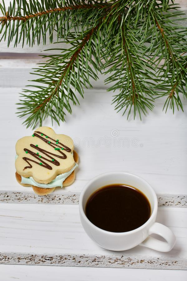 Desserts for winter parties. Sweets and spruce branch. Marshmallows and a cup of coffee. Desserts for winter parties. Sweets spruce branch stock image