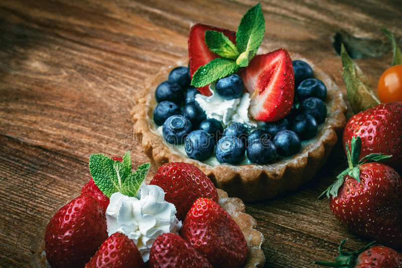 Desserts on wooden table royalty free stock photo