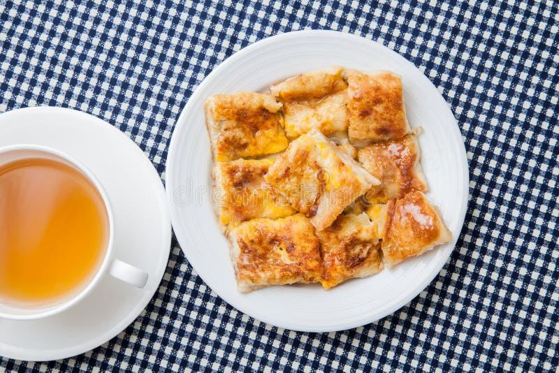 Dessertstijl van gebraden Roti met banaan stock fotografie