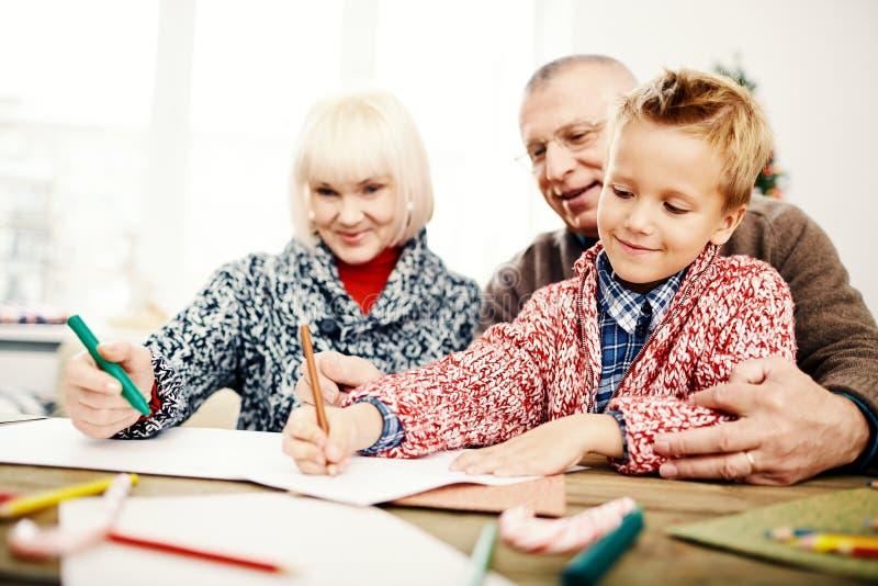 Dessin avec des grands-parents images stock