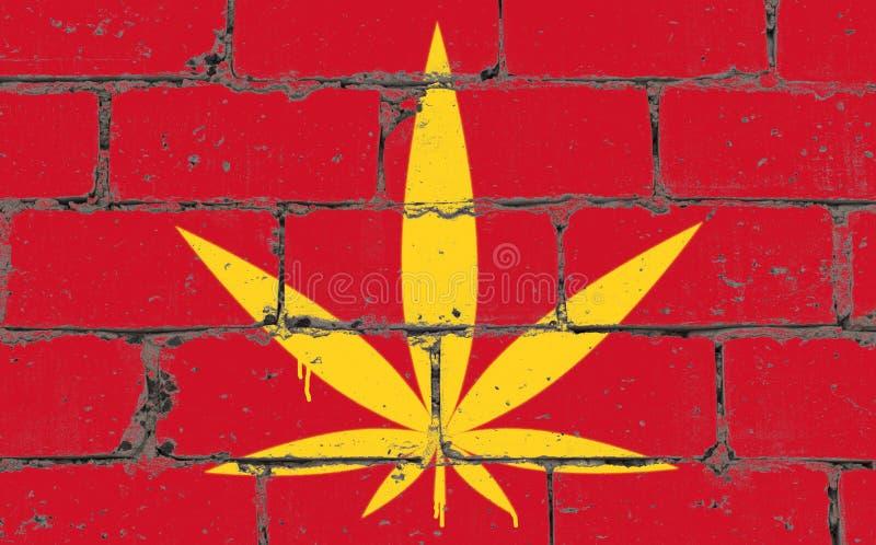 Dessin de jet d'art de rue de graffiti sur le pochoir Feuille de cannabis sur le mur de briques avec le drapeau Vietnam photo stock