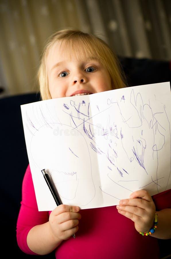 Dessin de petite fille avec le stylo images stock