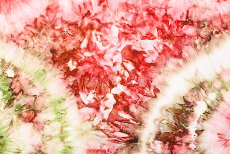Dessin rose et vert abstrait sur le batik en soie image stock
