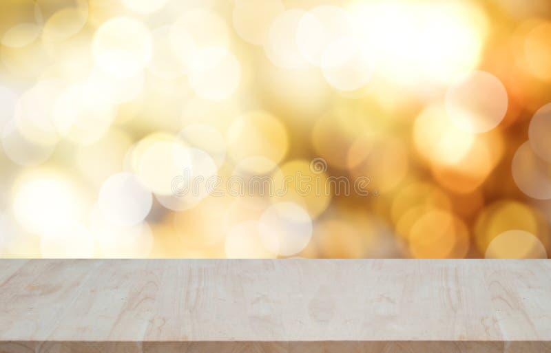 Dessus de table en bois vide sur le fond de Noël de lumière de bokeh photos stock