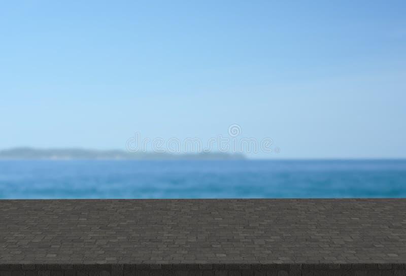 Dessus de table de pavé rond sur le fond brouillé de paysage marin images stock