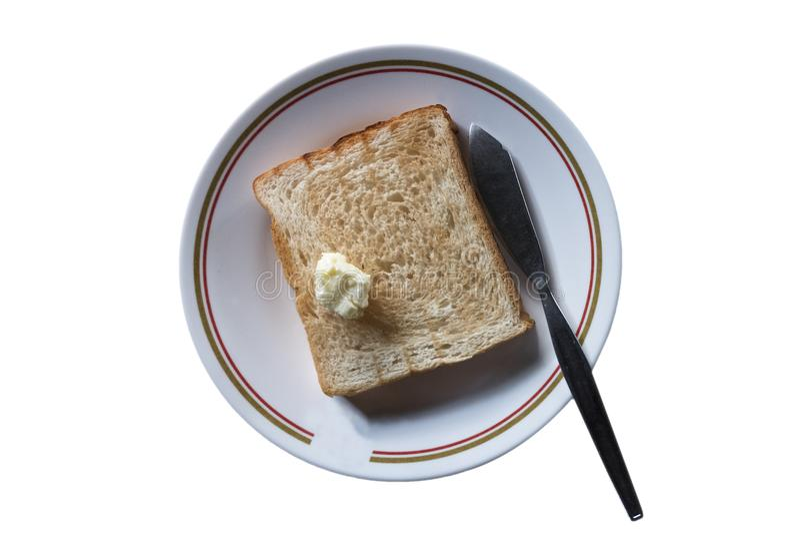 Dessus grillé de pain avec du beurre pour le petit déjeuner sur le plat blanc sur le whi image libre de droits