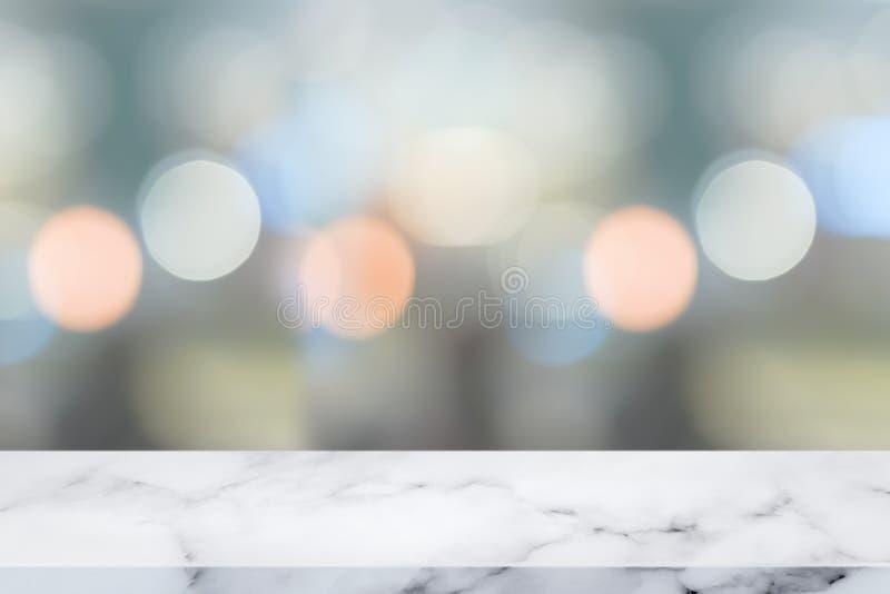 Dessus vide de la table de marbre blanche avec le fond abstrait de bokeh images stock