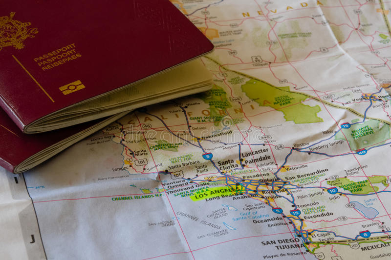 Destination USA. Planning a trip to the USA - two European passports on a map of the American West Coast, California stock photography