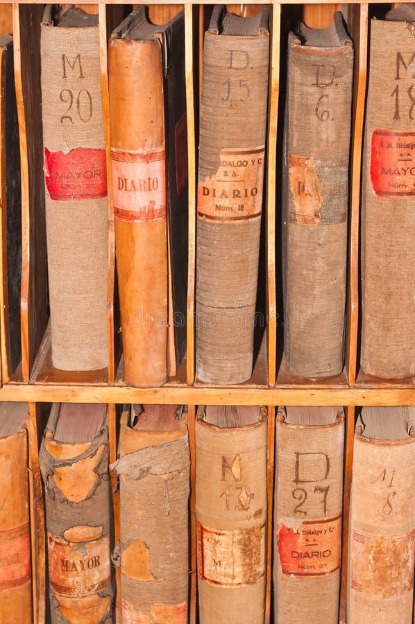 Destinerade huvudböcker för finans, hundra plus gamla år i en gammal tillbaka droom arkivfoto