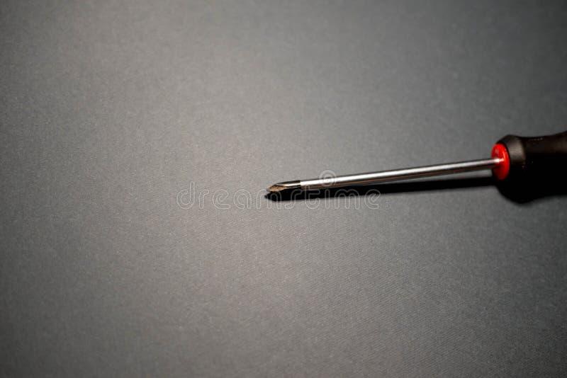 Destornilladores y tornillos imagen de archivo
