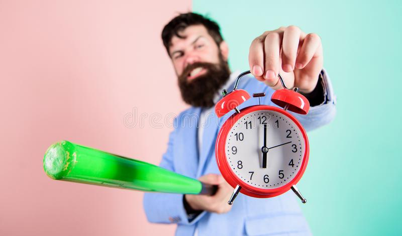 Destroy or turn off. Man suit hold clock and baseball bat in hands. Business discipline concept. Time management and. Discipline. Discipline and sanctions. Boss stock photos