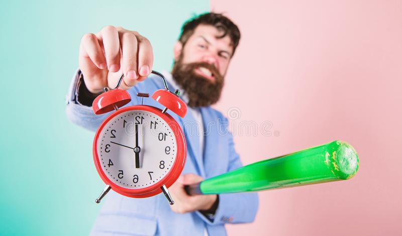 Destroy or turn off. Man suit hold clock and baseball bat in hands. Business discipline concept. Time management and stock photos