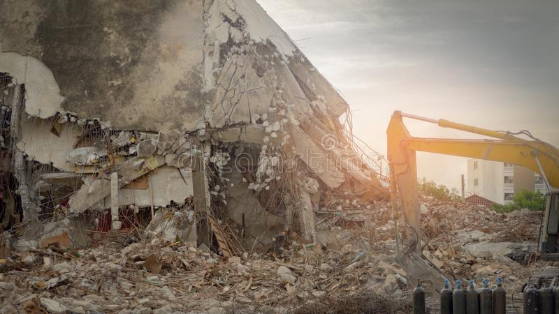 Destroyed building industrial. Building demolition by explosion. Abandoned concrete building with rubble and scrap. stock images