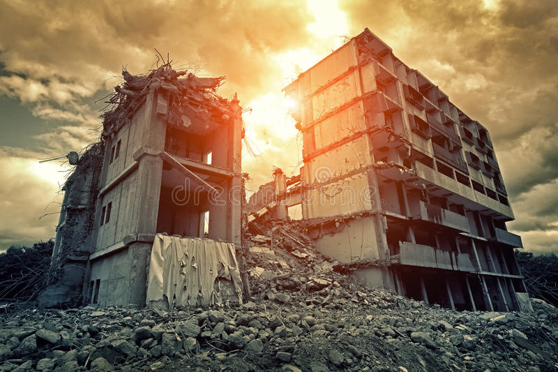 Destroyed building. Post-apocalyptic destroyed building in city stock photos