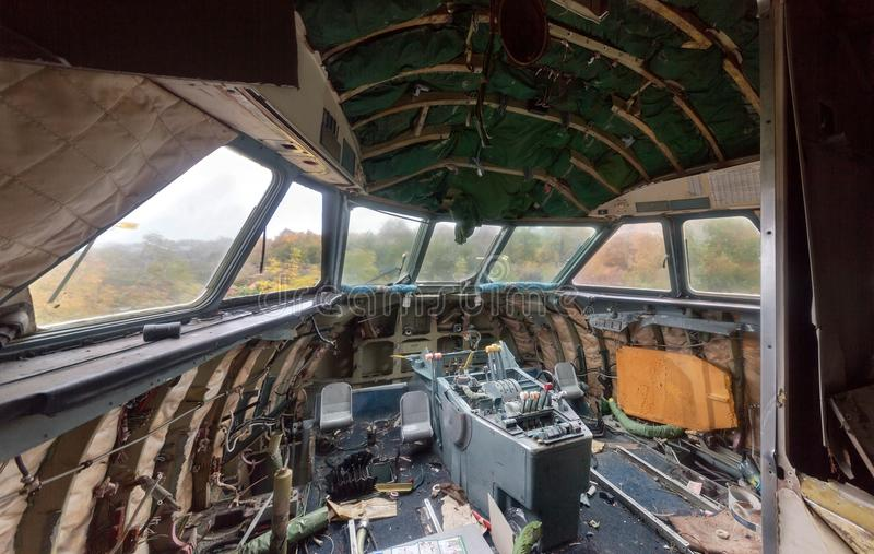 The destroyed cabin of the aircraft. With view of the autumn forest from the windows. View inside stock image
