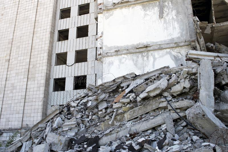 Destroyed large building with a blockage of concrete debris in the foreground. Background.  stock photography