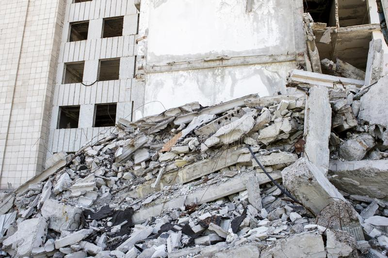 Destroyed large building with a blockage of concrete debris in the foreground. Background.  stock image