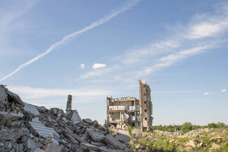 Destroyed large building with a blockage of concrete debris in the foreground. Background. Place for text stock photo