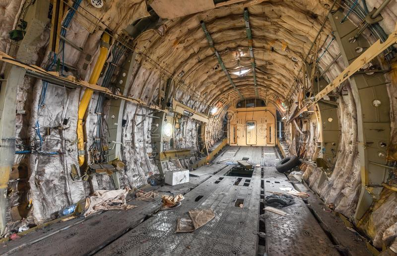 Destroyed and littered the cargo. Bay of a large transport aircraft stock photography