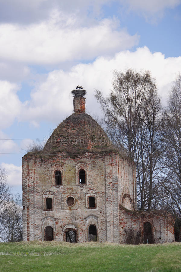Destroyed the Orthodox Church with a nest of storks royalty free stock photos