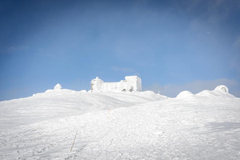 The destroyed Polish observatory is covered with snow royalty free stock images