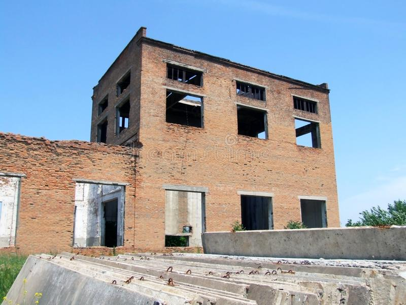 Destroyed red brick building. royalty free stock image