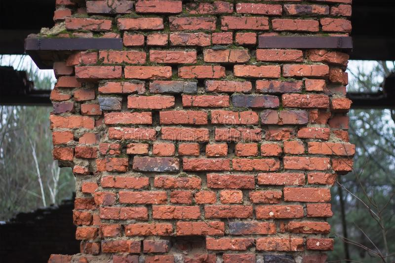 Destroyed red brick wall royalty free stock images