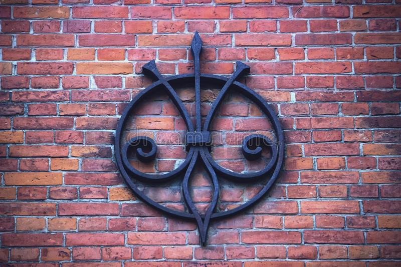 Destroyed red brick wall with iron remains royalty free stock image