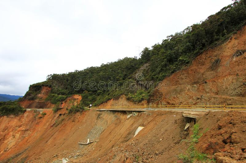 Destroyed road landslide damaged of powerful flood in the mountains of Colombia stock photography