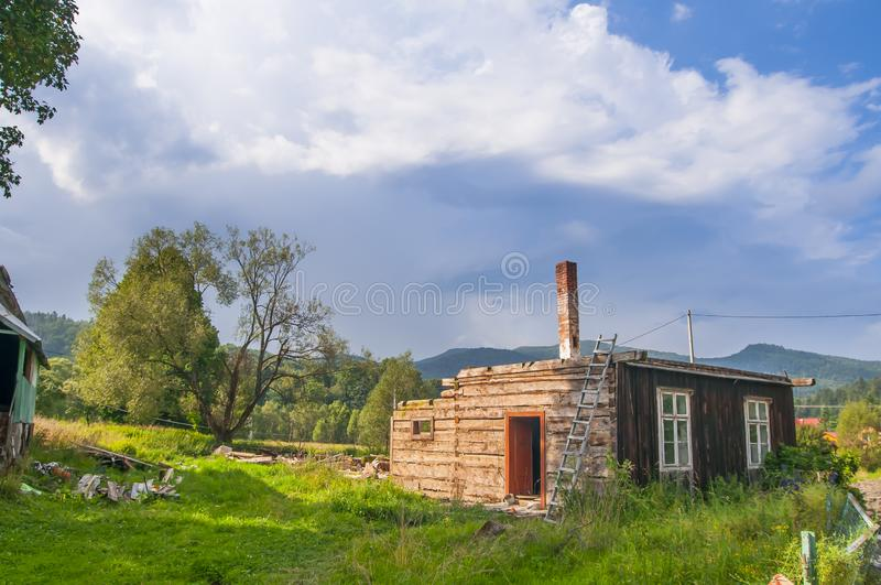 Destroyed ruined mountain hut, house in Bieszczady mountains, Cisna, Poland June 2018 stock photos