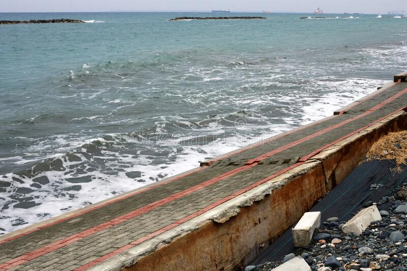 Destroyed by a storm promenade in Limassol on the island of Cyprus. The aftermath of the hurricane.  stock photos