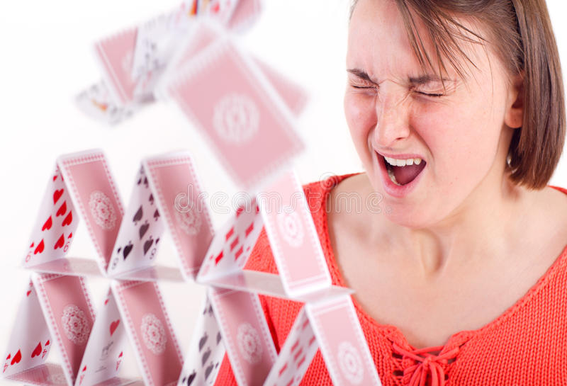 Destroying house of cards stock photography