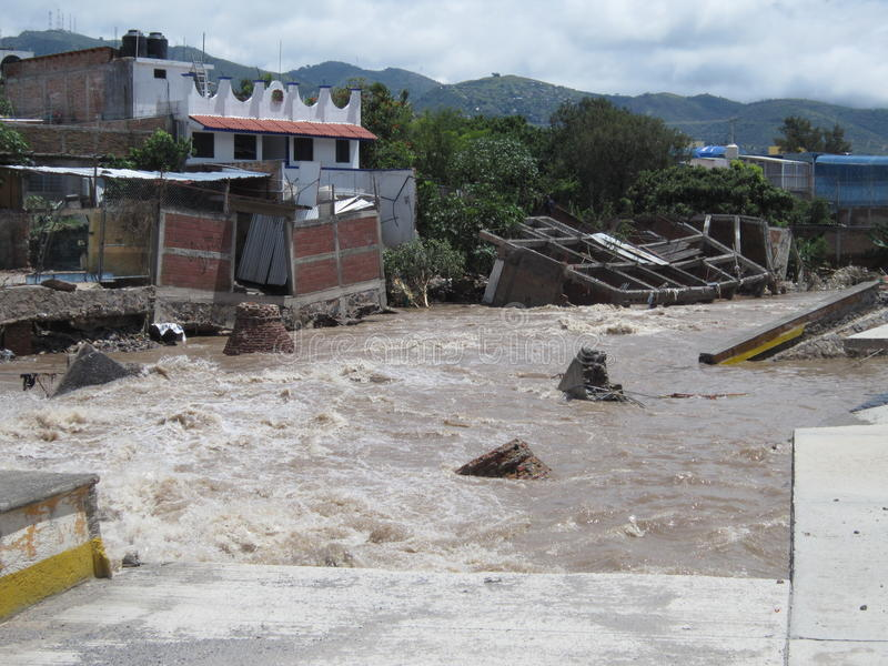 Destruction on the Huacapa River. Buildings have fallen into the huacapa river in chilpancingo mexico as it recedes from a flood on 9/19/2013 as a result of stock image