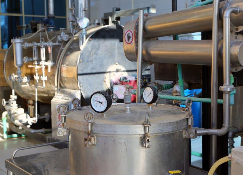 destylacja oleje istotni fabryczni fotografia royalty free