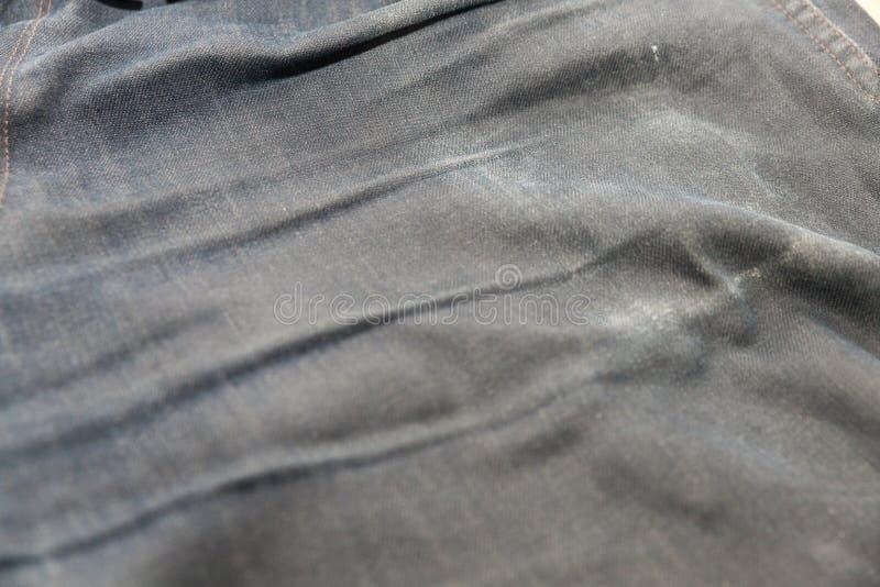 Desvaneça-se das calças de brim velhas foto de stock