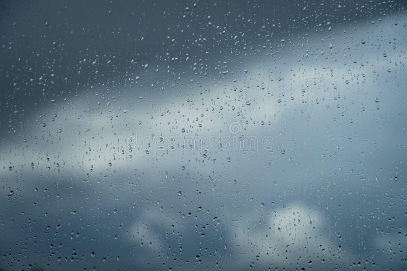 Deszcz, okno @ obrazy stock