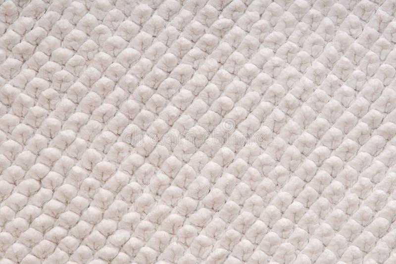 Det är en vit texturerad bakgrund arkivbilder