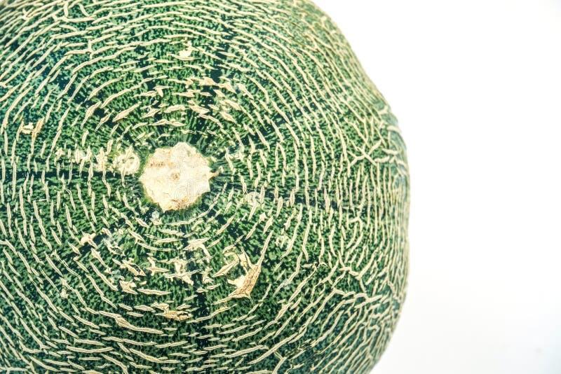Det abstrakta slutet upp av cantaloupmelonmelontextur, stänger sig upp den nya söta skivameloncantaloupmelon på trätabellen arkivbilder