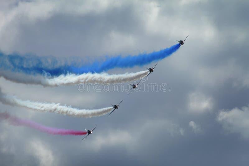 Det aerobatic skärmlaget för berömda röda pilar royaltyfri foto
