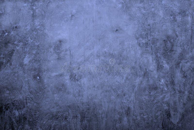 Det blåa idérika cirkuläret skrapade väggtextur - gullig abstrakt fotobakgrund arkivfoto