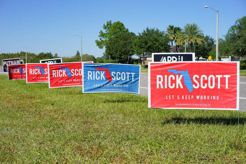Det färgrika valet röstar teckenröstningen för Rick Scott för den Florida regulatorn fotografering för bildbyråer