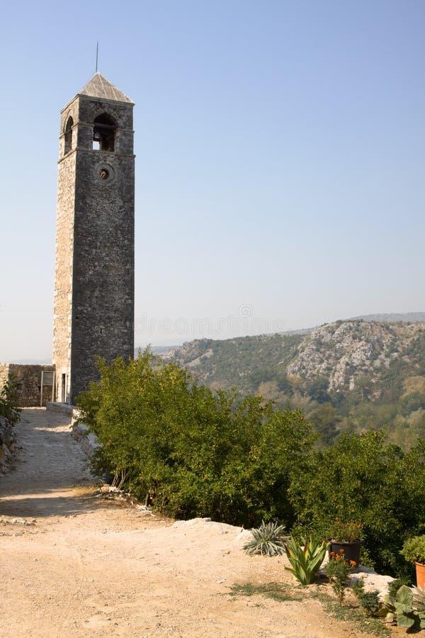 Det forntida klockatornet i Pocitelj royaltyfria foton