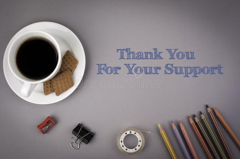Det gråa kontorsskrivbordet med inskriften - tacka dig för din Suppo arkivbilder