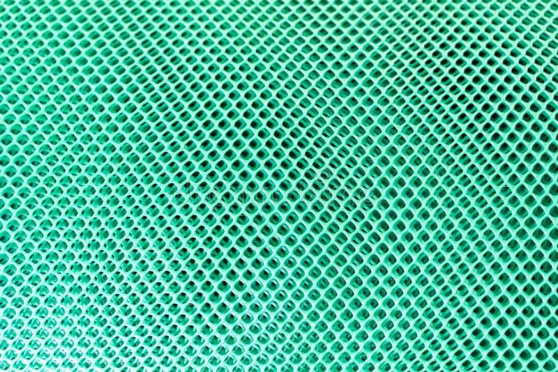 Det gröna plast- ingreppet ser som en illusion royaltyfria foton
