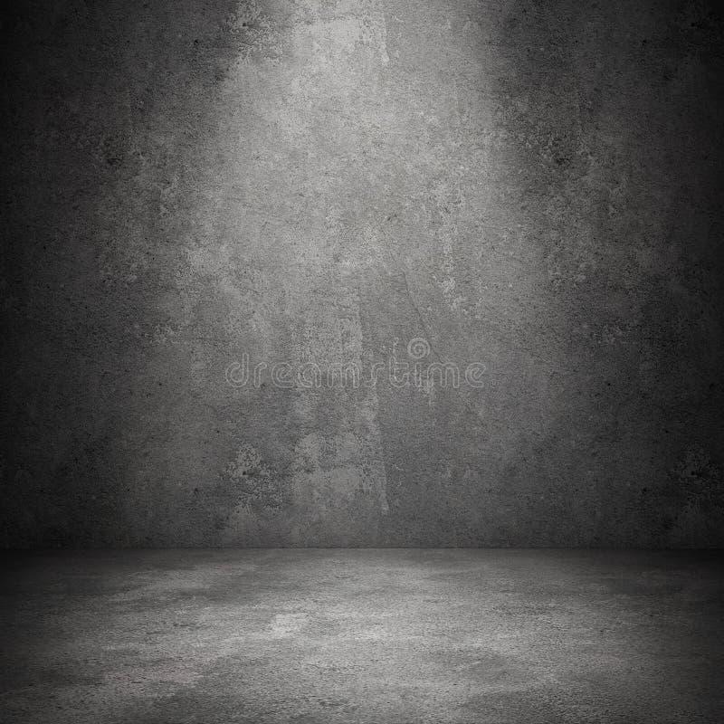 Det Grungy betongvägg- och stengolvet hyr rum som bakgrund royaltyfria bilder