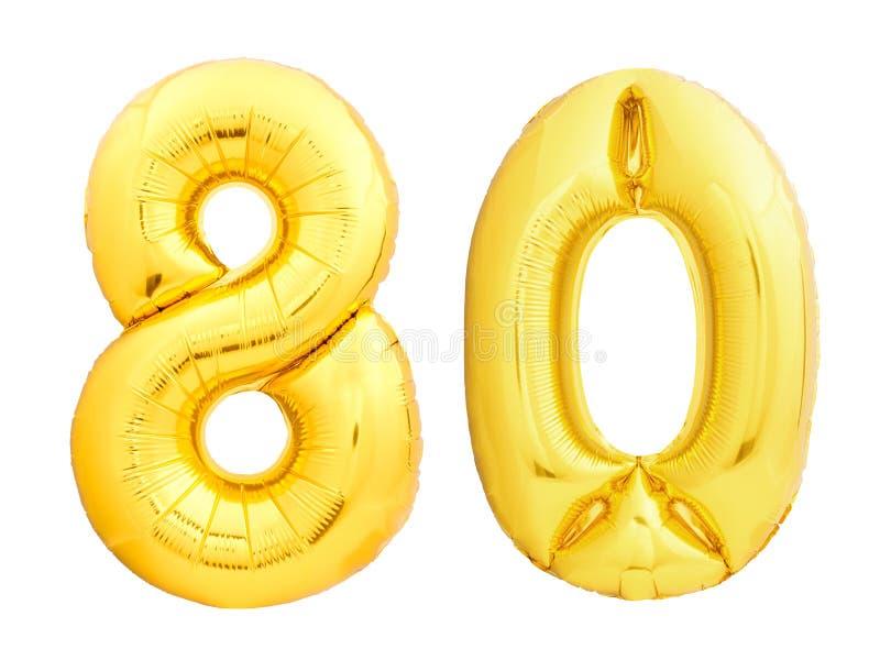 Det guld- numret 80 åttio gjorde av den uppblåsbara ballongen royaltyfri foto