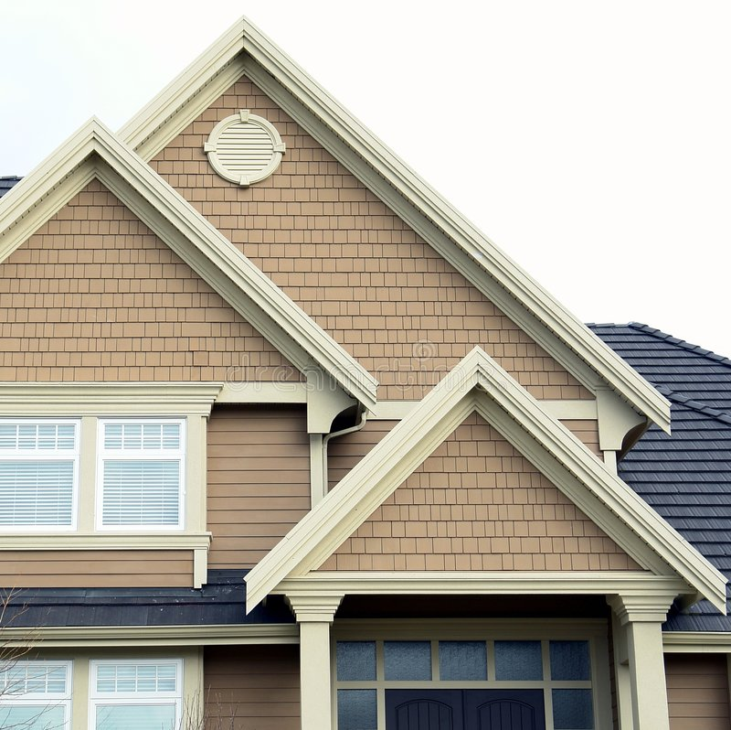 det home huset maximal taksidingen arkivbilder